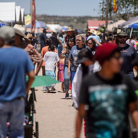 Shoppers crowd the dusty thoroughfare at the Gallup Flea Market Saturday.
