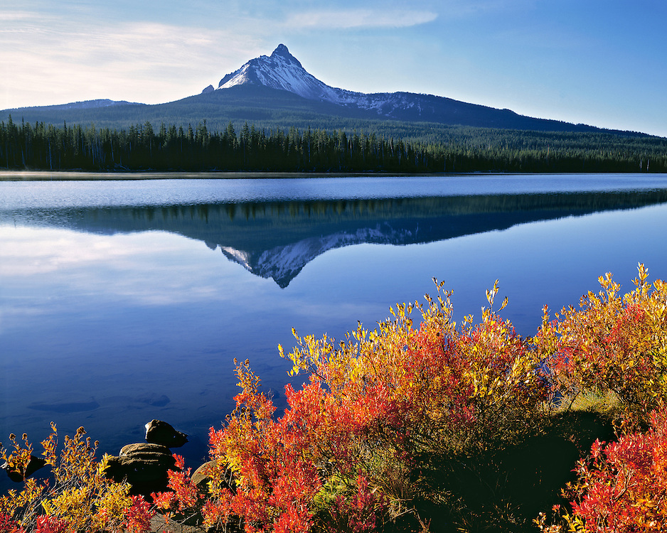 Huckleberry leaves are touched by the orange of autumn, with Big Lake and Mt. Washington as a backdrop, Cascade Range, Oregon. ©Ric Ergenbright