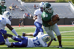 17 September 2011: Kevin Glock impedes the progress of Sean Conley during an NCAA Division 3 football game between the Aurora Spartans and the Illinois Wesleyan Titans on Wilder Field inside Tucci Stadium in.Bloomington Illinois.