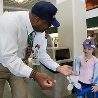 (PPAGE1) Monmouth Park 5/13/2006 Monmouth Park security guard David M. Bass performs a magic trick for 6 year old Samantha Meagher of Manalapan who was sporting a very cool horse hat.    Michael J. Treola Staff Photographer.....MJT