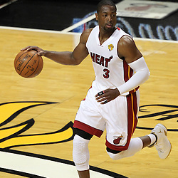Jun 19, 2012; Miami, FL, USA; Miami Heat shooting guard Dwyane Wade (3) dribbles against the Oklahoma City Thunder during the first quarter in game four in the 2012 NBA Finals at the American Airlines Arena. Mandatory Credit: Derick E. Hingle-US PRESSWIRE