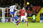 Walsall's Paul Downing heads clear during the Sky Bet League 1 match between Swindon Town and Walsall at the County Ground, Swindon, England on 24 November 2015. Photo by Shane Healey.