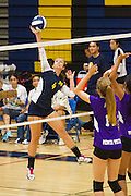 Milpitas senior Maggie Brown (4) spikes the ball against Monta Vista High School on Sept. 10, 2012.  Milpitas would go on to lose in 4 sets, 7-25, 16-25, INSERT SCORE, 17-25.  Photo by Stan Olszewski/SOSKIphoto.
