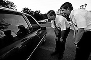Elder Merrill, left, and Balls strike-up a conversation with a passing motorist, while on their way to see a church member, on Sunday afternoon, May 25, 2008.