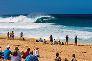 Spectators on the beach watching the action at the Banzai Pipeline, North Shore, Oahu, Hawaii