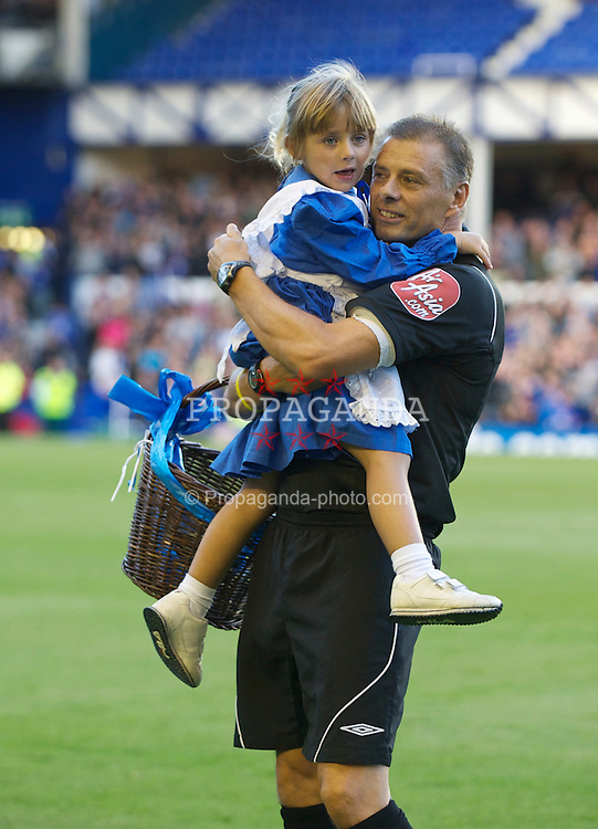 LIVERPOOL, ENGLAND - Wednesday, August 4, 2010: Referee Mark Halsey with his daughter as an Everton toffee girl as he takes charge of Everton against Everton de Vina del Mar of Chile during a preseason friendly match at Goodison Park. (Pic by: David Rawcliffe/Propaganda)