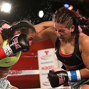 Nydia Feliciano (L) and Noemi Bosques fight during a Telemundo Boxeo boxing match at the A La Carte Pavilion on Friday,  March 13, 2015 in Tampa, Florida.  Feliciano won the bout by split decision. (AP Photo/Alex Menendez)