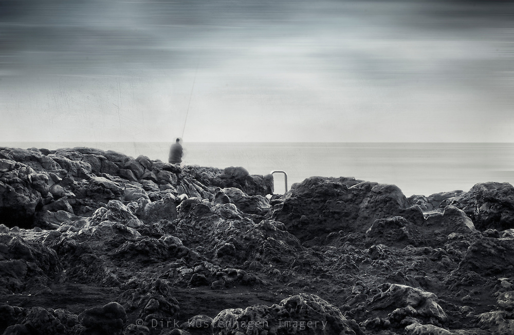 Angler sitting on the edge of the sea trying to catch some fish. Long exposure.<br /> <br /> Prints: http://society6.com/DirkWuestenhagenImagery/the-art-of-patience_Print
