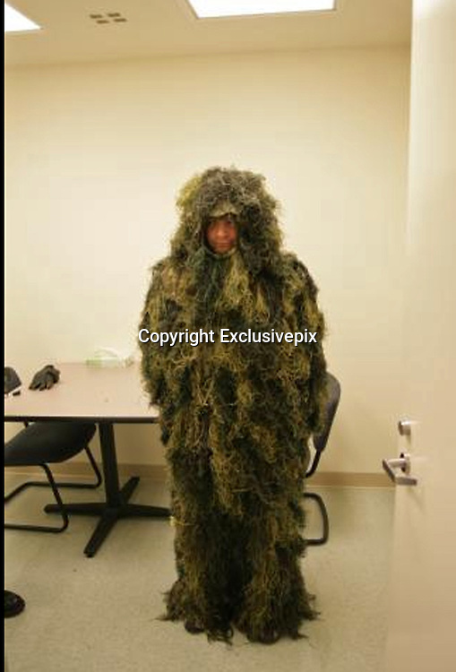 15/10/2010<br /> Bungling crook dons military-style Ghillie suit in elaborate plot to burgle US museum<br /> <br /> Burglars like to blend in, not be seen, but would-be American crook took his camouflage to new heights. <br /> Dressed in a full combat suit more often donned by hunters and military snipers, known as a Ghillie suit, police say Greg Liascos intended to break into a museum by cutting a hole through the facility's wall.<br /> And it almost worked!<br /> <br /> Liascos was only found by a police dog which appeared to be biting at the ground in nearby woods. 'His yelp gave him away,' police confirmed.<br /> The 36-year-old stands accused of attempting to burgle the Rice Northwest Museum of Rocks and Minerals in Hillsboro, Oregon after a caretaker discovered unusual dust and debris gathering over a number of days and nights.<br /> <br /> Digging a little deeper, the caretaker found his way to an elevator shaft behind the wall of the toilets at the museum, where he found a large hole in the plywood wall.<br /> He then reported his discovery to the Washington County Sheriff's Office who in turn set up surveillance and security equipment. <br /> Sure enough, deputies said, patrol officers were alerted of a break-in the very next day leading to a search of the surrounding area using police dogs. The pooch led officers to a wooded enclave where, after appearing to be biting at the ground, he outed Liascos. <br /> Liascos, of Portland, was arrested on charges of burglary and criminal mischief and is being held in custody. <br /> Nothing was stolen from the museum. A sheriff's spokesman said the museum' s existing security would have likely triggered a police response once Liascos got into the building. <br /> <br /> Photo Shows: Well hidden: Greg Liascos is accused of breaking into a US museum dressed in military-style Ghille camouflage outfit<br /> &copy;Exclusivepix