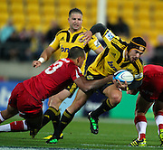 Hurricanes Jayden Hayward skips past Reds Will Chambers.  Investec Super 15 rugby match - Hurricanes v Reds, at Westpac Stadium, Wellington, New Zealand on Saturday 30 April 2011. Photo: Justin Arthur / photosport.co.nz