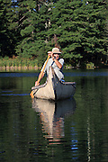 Jack Gribble, of Barnes, Wisconsin, paddles his homemade birchbark canoe on the Eau Claire River.
