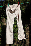 washing line with pants hanging to dry