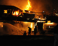 Oxford fireman battle a fire at the building that formerly housed the Gin in Oxford, Miss. on Saturday, March 6, 2010.