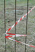 a spot cordoned off with red and white safety tape
