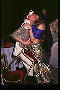 2 people kissing, Fancy dress party at Christies, 1984  approx© Copyright Photograph by Dafydd Jones 66 Stockwell Park Rd. London SW9 0DA Tel 020 7733 0108 www.dafjones.com