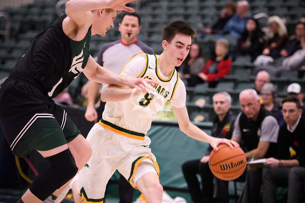 2nd year guard Benjamin Hillis (8) of the Regina Cougars in action during the home opener on November  10 at Centre for Kinesiology, Health and Sport. Credit: Arthur Ward/Arthur Images