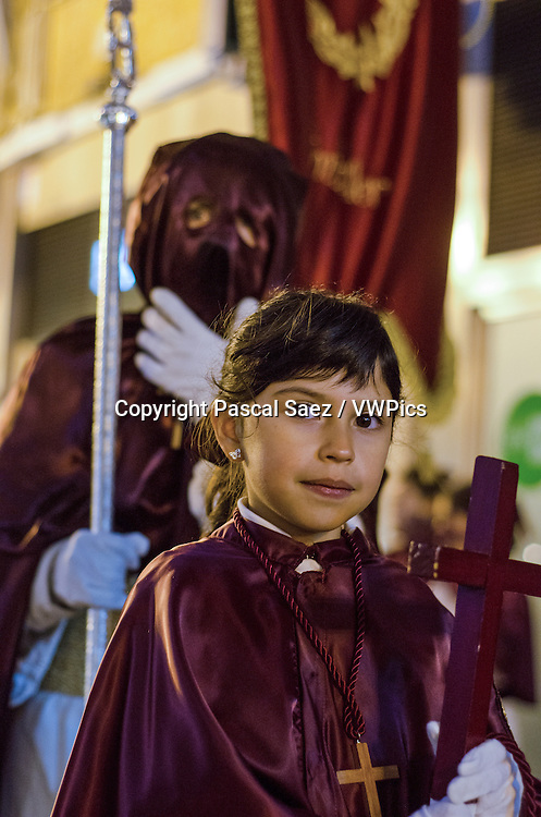 Thursday 28 March 2013 - Santander, Spain - Holy Thursday procession underway in Santander (part of Semana Santa, or Holy Week). Hooded penitents walk through the city centre at night carrying floats with effigies of Jesus Christ or the Virgin Mary, to the music of marching bands.<br />