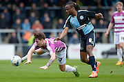 Sam Muggleton of Barnet FC falls under pressure from Wycombe Wanderers midfielder Marcus Bean (8) during the Sky Bet League 2 match between Wycombe Wanderers and Barnet at Adams Park, High Wycombe, England on 16 April 2016. Photo by Dennis Goodwin.