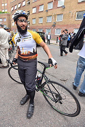 © Licensed to London News Pictures. 14/07/2017. London, UK. A Hajj cyclist stands with his bicycle. Muslim cyclists gather at the East London Mosque in Whitechapel to set out on the 'Hajj Ride', the first ever charity cycle ride from London to Medina in Saudi Arabia.  The 3,500km, 6 week ride will pass through 8 countries raising funds for medical aid in Syria.  Intended to champion cycling in Muslim society, the ride also aims to satisfy one of the five pillars of Islam, being the Hajj pilgrimage to Mecca.  Photo credit : Stephen Chung/LNP