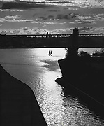 View of Portage Bay as seen from the west side of the Montlake Bridge. A two-masted sailing craft, moved into the sun-stream. (Josef Scaylea / The Seattle Times, 1961)