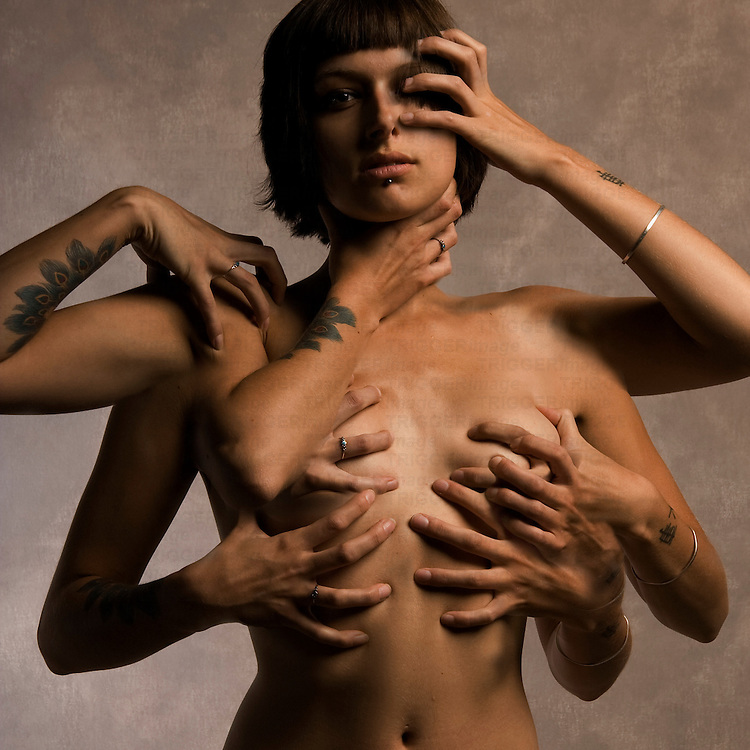 A naked young woman with many arms and hands covering her body