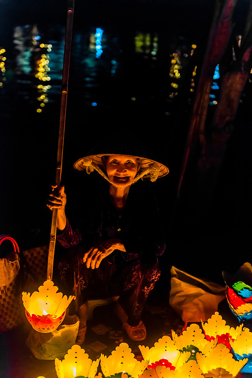 Old woman selling paper lanterns, Hoi An Full Moon Lantern Festival, Hoi An, Vietnam.