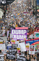 © Licensed to London News Pictures. 04/02/2017. London, UK. Protestors march through London in a demonstration against U.S President Donald Trump's Executive Order banning refugees and immigrants from a number of Muslim-majority countries. Protestors join campaign groups including Stop the War, Stand up to Racism, Muslim Association of Britain, in a march from the U.S Embassy in London to Downing Street. Photo credit: Peter Macdiarmid/LNP