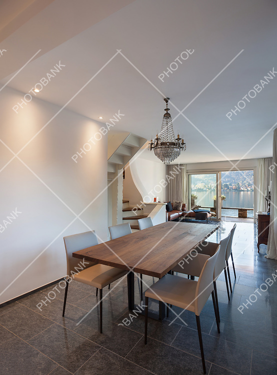 Interior of house, dining room with wooden table