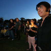 Elvis tribute artist Brad Mitchell of Spokane Washington joins others at the Elvis Presley birthplace Wednesady for a candlelight rememberance walk to kick off thsi year's Elvis Presley Festival.