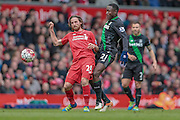 Joe Allen (Liverpool) plays the ball back to Simon Mignolet (Liverpool) during the Barclays Premier League match between Liverpool and Stoke City at Anfield, Liverpool, England on 10 April 2016. Photo by Mark P Doherty.