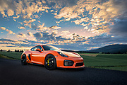 Image of a 2016 Gulf Orange Porsche GT4 in the Palouse, Washington, Pacific Northwest