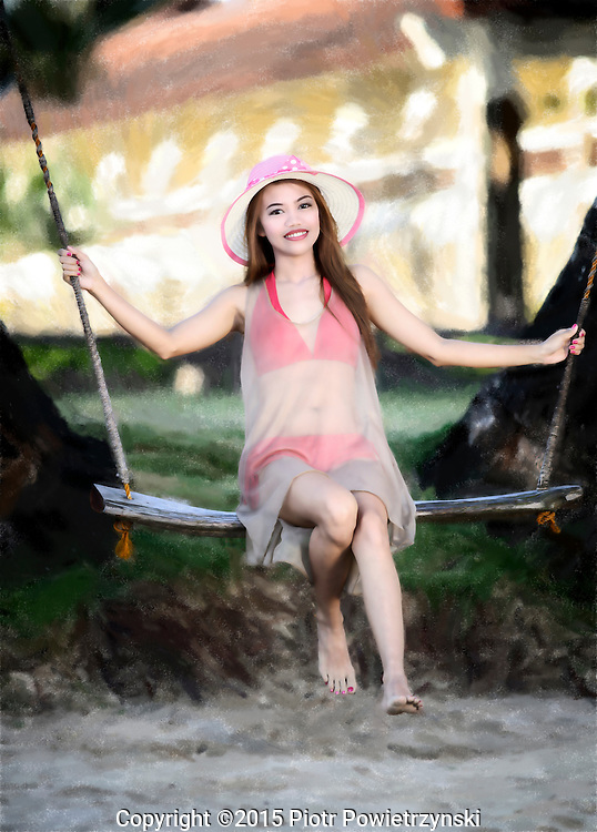 Young woman on swing. Palawan, Philippines, Asia