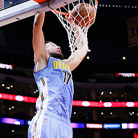02 October 2015: Denver Nuggets forward Joffrey Lauvergne (77) dunks the ball during the Los Angeles Clippers 103-96 victory over the Denver Nuggets, in a preseason game, at the Staples Center, Los Angeles, California, USA.