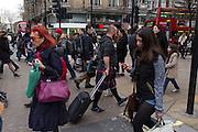 Man wearing a Scottish kilt in Oxford street, London busiest street.