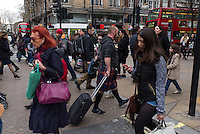 Man wearing a Scottish kilt in Oxford street, London busiest street.