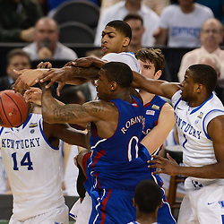 Apr 2, 2012; New Orleans, LA, USA; Kansas Jayhawks forward Thomas Robinson (0) loses control of the ball as Kentucky Wildcats guard Darius Miller (1), forward Michael Kidd-Gilchrist (14), forward Anthony Davis (top in white) defend during the first half in the finals of the 2012 NCAA men's basketball Final Four at the Mercedes-Benz Superdome. Mandatory Credit: Derick E. Hingle-US PRESSWIRE