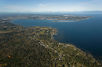 An aerial view of the Comox Valley from a southern aspect looking north, with Georgia Strait and mainland British Columbia in the background.  The Comox Valley, Vancouver Island, British Columbia, Canada.