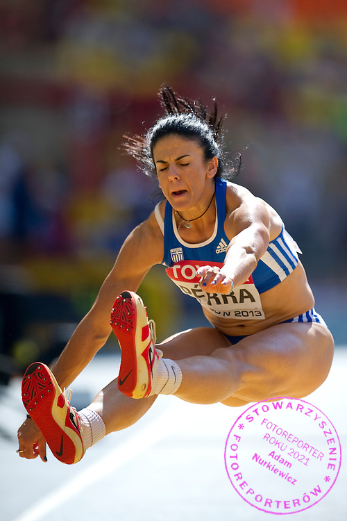 Anastasia Perra from Grecce competes in women's triple jump qualification during the 14th IAAF World Athletics Championships at the Luzhniki stadium in Moscow on August 13, 2013.<br /> <br /> Russian Federation, Moscow, August 13, 2013<br /> <br /> Picture also available in RAW (NEF) or TIFF format on special request.<br /> <br /> For editorial use only. Any commercial or promotional use requires permission.<br /> <br /> Mandatory credit:<br /> Photo by © Adam Nurkiewicz / Mediasport