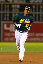 September 20, 2011; Oakland, CA, USA;  Oakland Athletics center fielder Michael Taylor (23) rounds the bases after hitting his first Major League home run against the Texas Rangers during the fifth inning at O.co Coliseum.