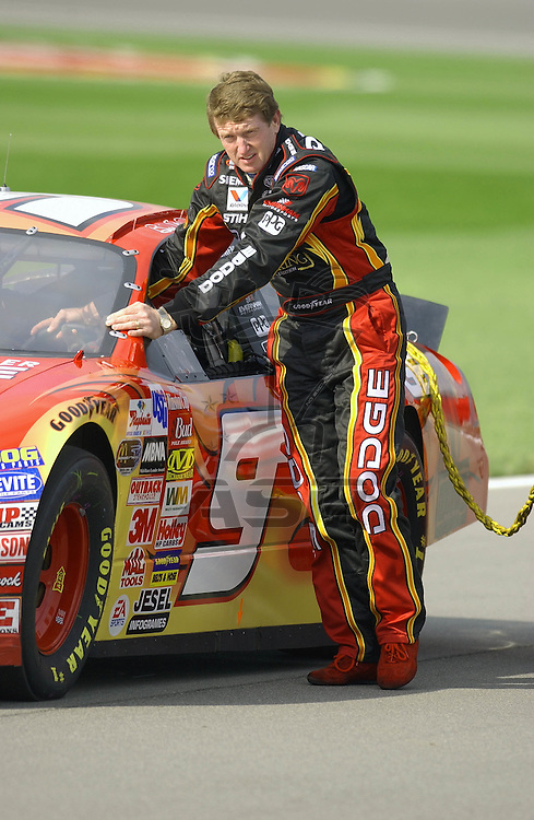 Bill Elliot pushes his car on to the qualifying grid for the Banquet 400 at the Kansas Speedway