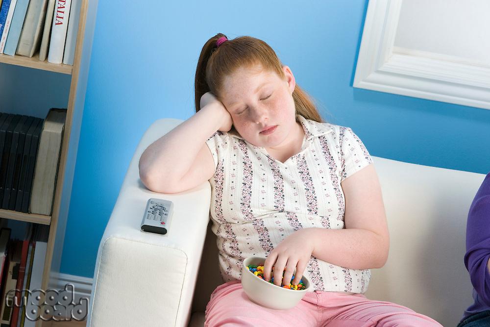 Overweight girl sleeping on sofa