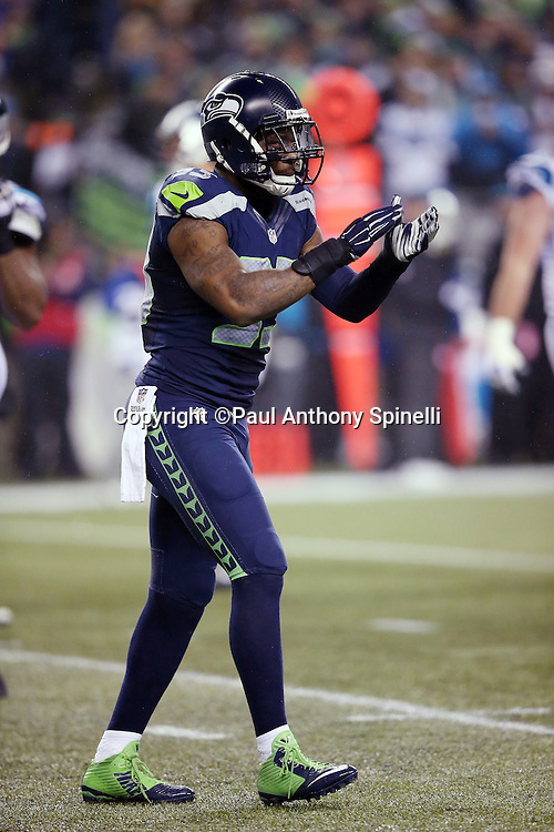 Seattle Seahawks defensive end O'Brien Schofield (93) claps his hands as he celebrates after complaining about and getting a fourth quarter penalty on the Carolina Panthers during the NFL week 19 NFC Divisional Playoff football game against the Carolina Panthers on Saturday, Jan. 10, 2015 in Seattle. The Seahawks won the game 31-17. ©Paul Anthony Spinelli