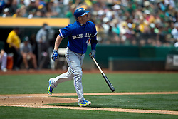 OAKLAND, CA - JULY 23:  Josh Donaldson #20 of the Toronto Blue Jays hits a home run against the Oakland Athletics during the fifth inning at O.co Coliseum on July 23, 2015 in Oakland, California. The Toronto Blue Jays defeated the Oakland Athletics 5-2. (Photo by Jason O. Watson/Getty Images) *** Local Caption *** Josh Donaldson