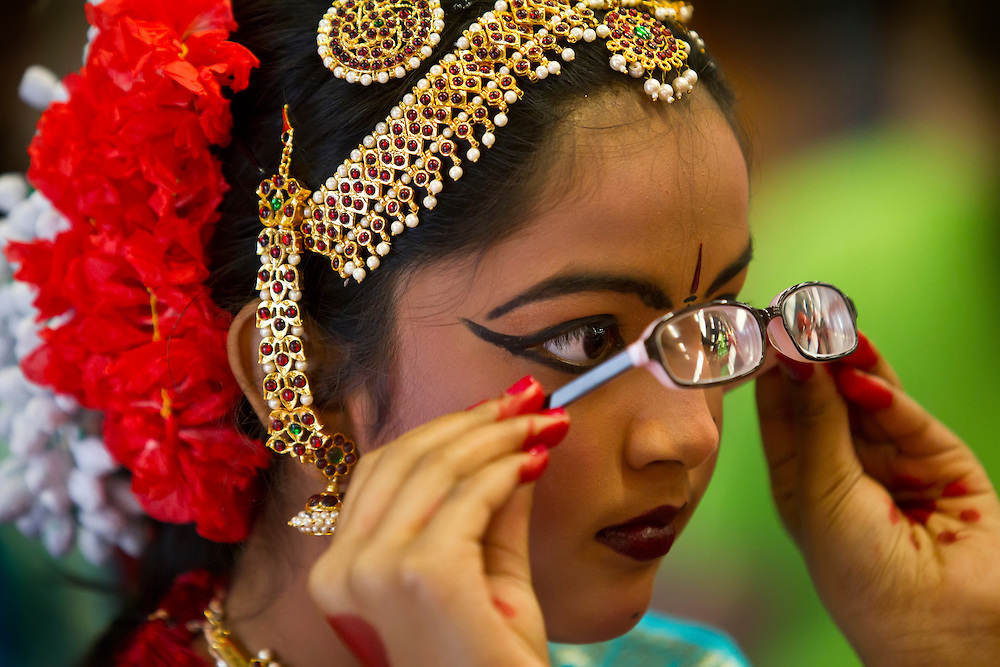 Priyanka Kotipalli, 10, of Overland Park, Kan., sneaked a peek through her glasses before performing without them on at the Wyandotte County Ethnic Festival 2011 with her fellow dancers from Nartan Dancers of Overland Park at the Kansas City Kansas Community College Field House. The admission-free event featured music, performances and food from cultures who have immigrated to the Kansas City metro area.