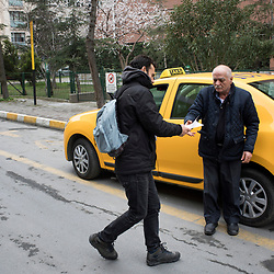 A volunteer distributes flyers supporting the No vote in Sisli, in Central Istanbul on March 10, 2017.<br /> On April 16, 2017, Turkish citizens will vote on proposed changes on the constitution that could replace the current parliamentary government system with a presidential one.
