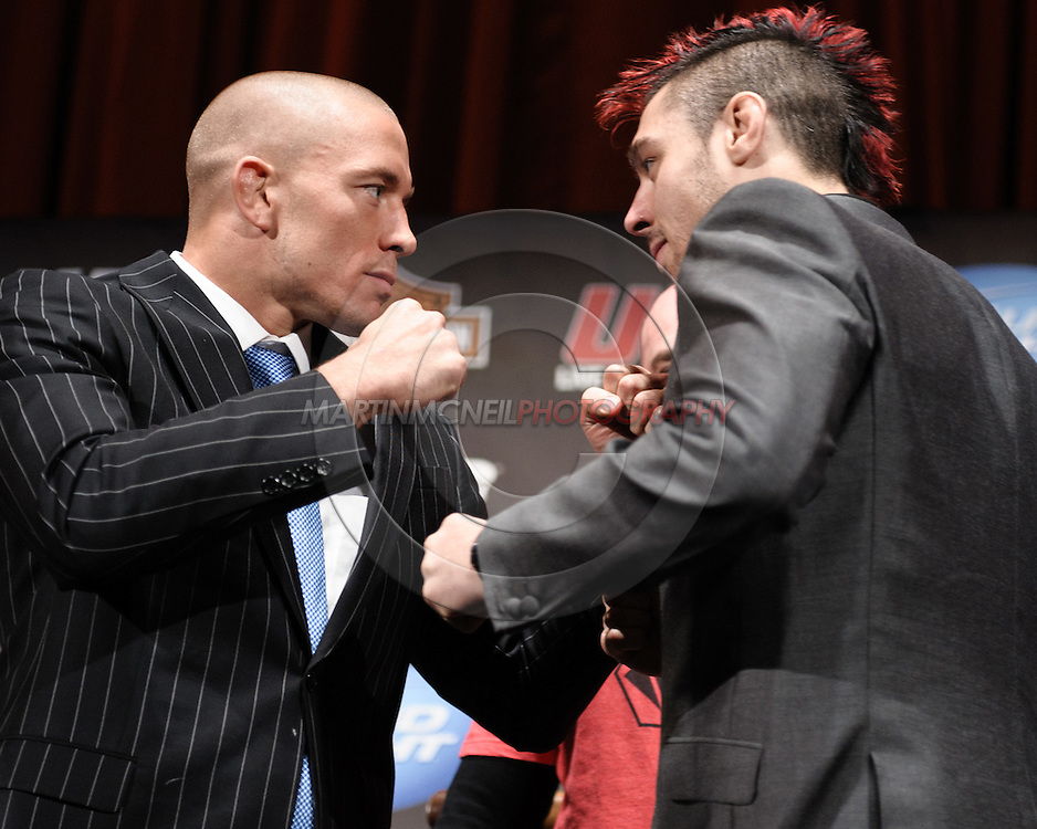 "NEW YORK, NEW YORK, MARCH 24, 2010: UFC welterweight champion Georges St. Pierre (left) and challenger Dan Hardy face off during the pre-fight press conference for ""UFC 111: St. Pierre vs. Hardy"" inside Radio City Music Hall in New York City"