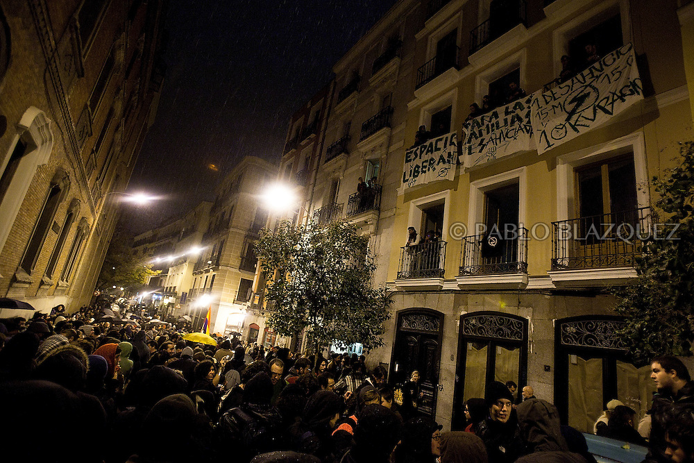 Protesters squat a building and hang banners after an 'indignant' demonstration in Madrid on November 20, 2011 against spending cuts, high unemployment and political corruption, one day before general election. Spain's so-called 'indignant' protest movement was born when thousands of people set up camp in Madrid's Puerta del Sol square ahead of May 22 municipal elections.