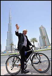 The London Mayor Boris Johnson rides a bike around the Burj Khalifa to help on cycle safety in Dubai, . The Mayor is on a 2 day tour of the UAE, Tuesday April 16, 2013. Photo By Andrew Parsons / i-Images