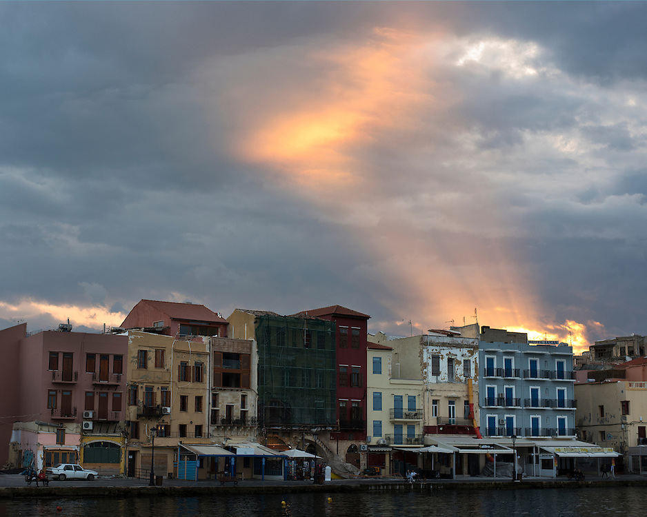 A sunset over the Venetian harbor of Chania, Crete, Greece.