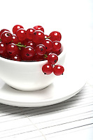 Red currants in white cup